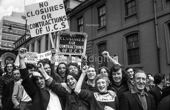 Young shipyard workers march out of Upper Clyde Shipyards, Glasgow 1971 to join a march of 80,000 trades union members opposing the threatened closure of the yards. They occupied the yards in a work-in - Martin Mayer - 1971-06-23