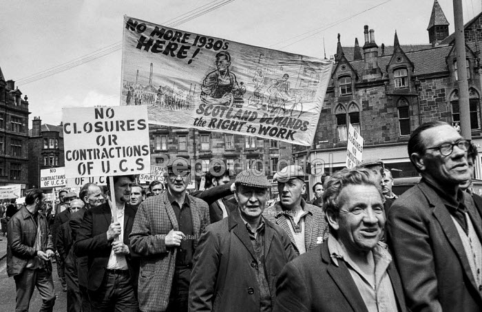 Shipyard workers from Upper Clyde Shipbuilders, Glasgow joined in a march and rally by 80,000 trades union members opposing the threatened closure of the yards. They later occupied the yards in a work-in, which saved some of the yards for a while. - Martin Mayer - 1970-06-23