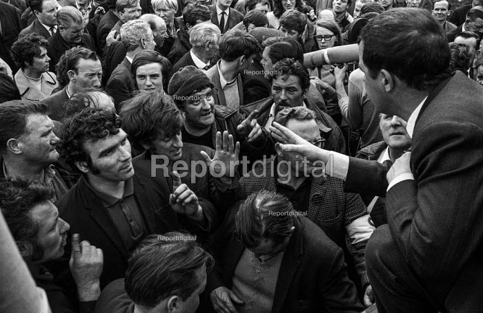 Shipyard workers from Upper Clyde Shipyards, Glasgow talk to one of their leaders, Jimmy Airlie, after a march and rally of 80,000 trades union members opposing the threatened closure of the yards. They later occupied the yards in a work-in, which saved some of the yards for a while. - Martin Mayer - 1971-06-23