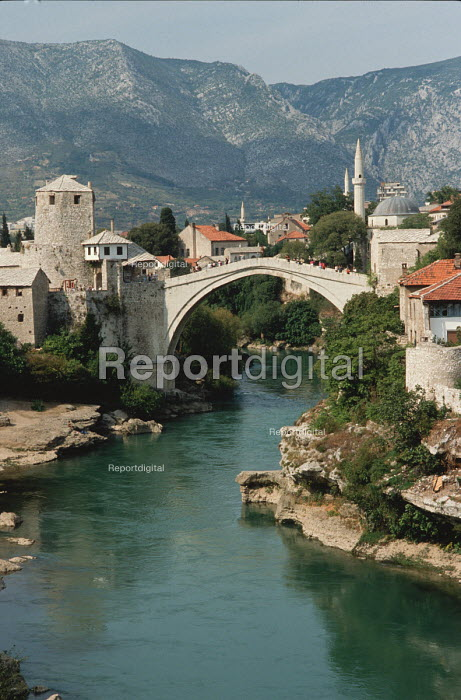 The original Stari Most the old 16th century Ottoman bridge over the Neretva river in Mostar, Bosnia in 1990, before it was blown up during the civil war by Croatian forces. It was eventually rebuilt in 2004. - Martin Mayer - 1990-09-07