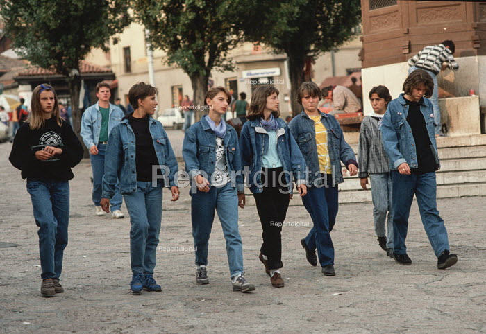 Denim clad girls walk confidently through the centre of Sarajevo, Bosnia, after the break up of Yugoslavia. Denim was a Western import highly prized by the young during the Communist and post Communist era in Eastern Europe - Martin Mayer - 1990-09-07