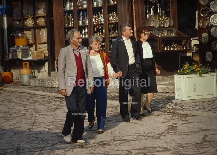 Couples taking an evening stroll through Sarajevo old town, Bosnia. - Martin Mayer - 1990-09-07
