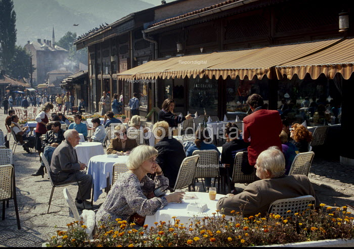 Cafe life in Sarajevo Old Town, Bosnia. - Martin Mayer - 1990-09-07