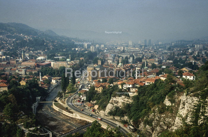 View of Sarajevo before the civil war from a nearby hill showing the Miljacka river, the Ottoman Old Town in the middle distance and the 19th century Austro-Hungarian quarter behind. - Martin Mayer - 1990-09-07