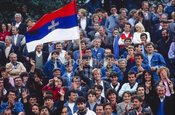 Supporters of the Bosnian Serb nationalist Serbian Democratic Party cheer a speech by their leader Radovan Karadzic at an election rally in Muslim majority town of Gorazde in eastern Bosnia. - Martin Mayer - 1990-09-09