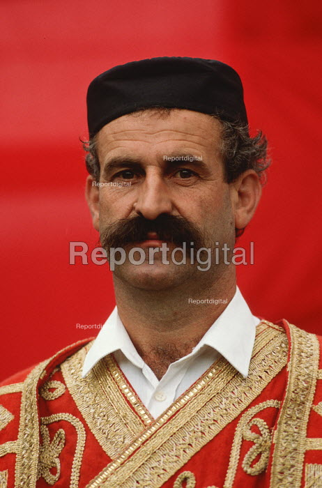 A supporter of the Bosnian Serb nationalist Serbian Democratic Party, dressed in Serbian national costume, at an election rally in Muslim majority town of Gorazde in eastern Bosnia. - Martin Mayer - 1990-09-09