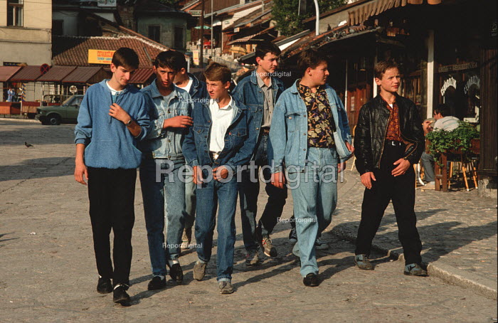 Teenage boys walking through the Old Town in Sarajevo, Bosnia, dressed in fashionable denim. Denim, preferably imported from the West, was a highly prized fashion item for young people in Eastern Europe during and after the Communist era - Martin Mayer - 1990-09-09