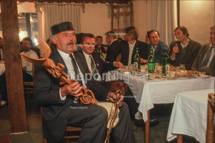 A musician plays traditional Serbian songs on a single stringed Gusle instrument at a gathering of Bosnian Serb nationalists in Gorazde following an election rally, Bosnia 1990 - Martin Mayer - 1990-09-10