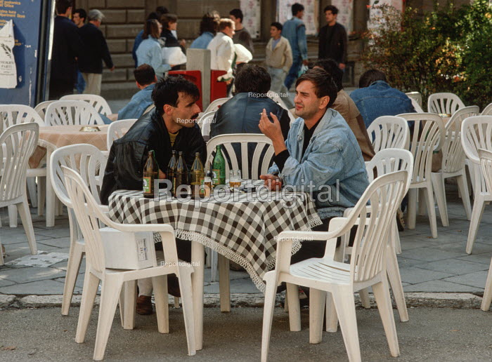 Young men enjoying a beer at an open air cafe in central Sarajevo, Bosnia, before the civil war - Martin Mayer - 1990-09-10