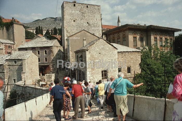 On the original Stari Most - the 16th century Ottoman bridge spanning the Neretva river in Mostar, Herzegovina, Western Bosnia, 1990 - Martin Mayer - 1990-09-12