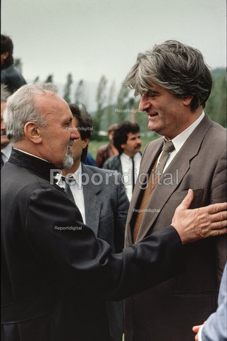 Serbian nationalist leader Radovan Karadzic is greeted by an Orthodox priest at an election rally in Gorazde, Eastern Bosnia. - Martin Mayer - 1990-09-10