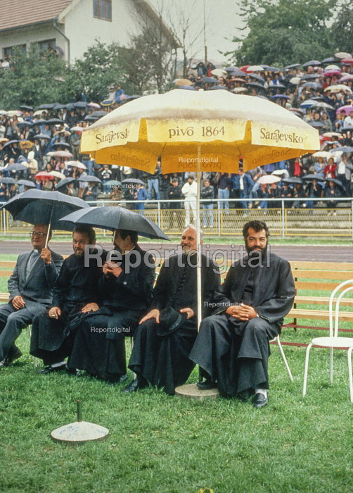 Orthodox priests sitting in pride of place at an election rally by the Bosnian Serb nationalist Serbian Democratic Party addressed by its leader Radovan Kardzic in Gorazde, Eastern Bosnia - Martin Mayer - 1990-09-10