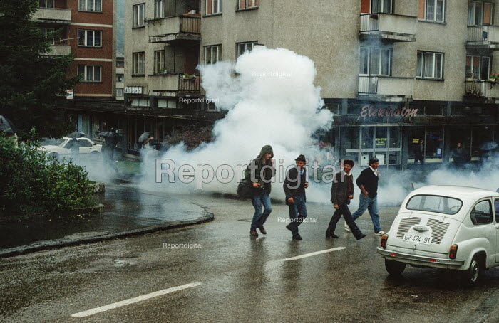 Police clear the streets with tear gas during a demonstration by transport workers in Gorazde, Eastern Bosnia - Martin Mayer - 1990-09-10