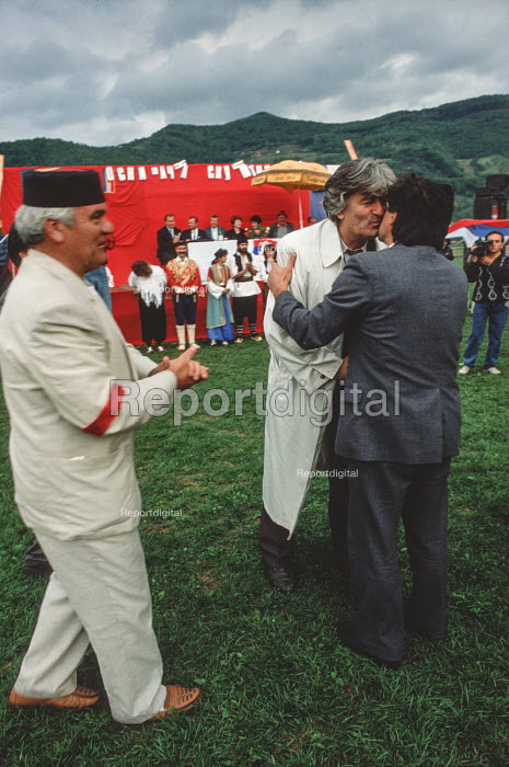 Radovan Karadzic, leader of the Bosnian Serb nationalist party - The Serbian Democratic Party - is greeted by a leading supporter on his arrival at an election rally in Gorazde, Eastern Bosnia during the 1990 election. Serbs were a minority in Gorazde but they tried, unsuccessfully ethnic cleansing for the town during the civil war. There is now a land corridor linking the town with the rest of Muslim Bosnia. - Martin Mayer - 1990-09-12