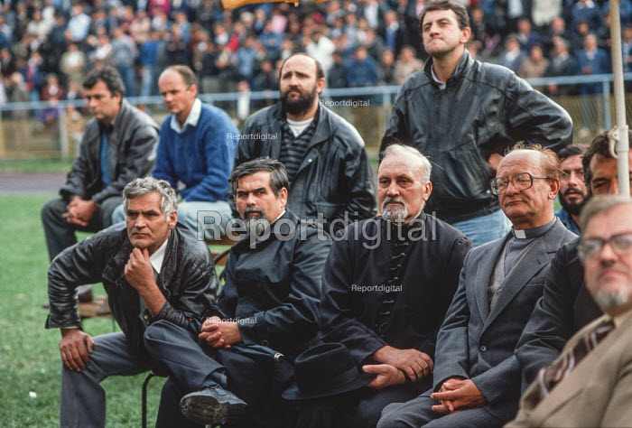 Orthodox priests join leather jacketed men at an election rally of the Bosnian Serb nationalist Serbian Democratic Party, addressed by its leader Radovan Karadzic, in the Muslim majority town of Gorazde in eastern Bosnia. - Martin Mayer - 1990-09-12