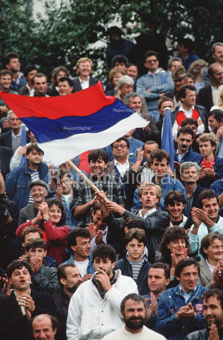 Supporters of the Bosnian Serb nationalist Serbian Democratic Party cheer a speech by their leader Radovan Karadzic at an election rally in Muslim majority town of Gorazde in eastern Bosnia. - Martin Mayer - 1990-09-12