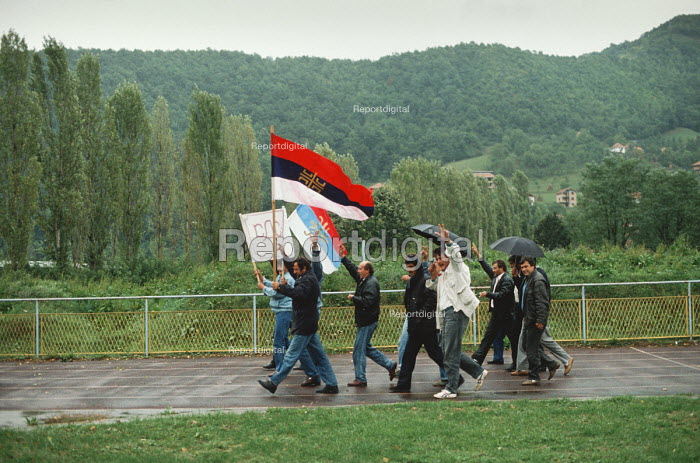 Supporters of the Bosnian Serb nationalist Serbian Democratic Party arrive for an election rally in Muslim majority town of Gorazde in eastern Bosnia. - Martin Mayer - 1990-09-12