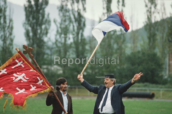 Supporters of the Bosnian Serb nationalist party Serbian Democratic Party waving Bosnian Serb flags at an election rally in the Muslim majority town of Gorazde in Eastern Bosnia - Martin Mayer - 1990-09-12