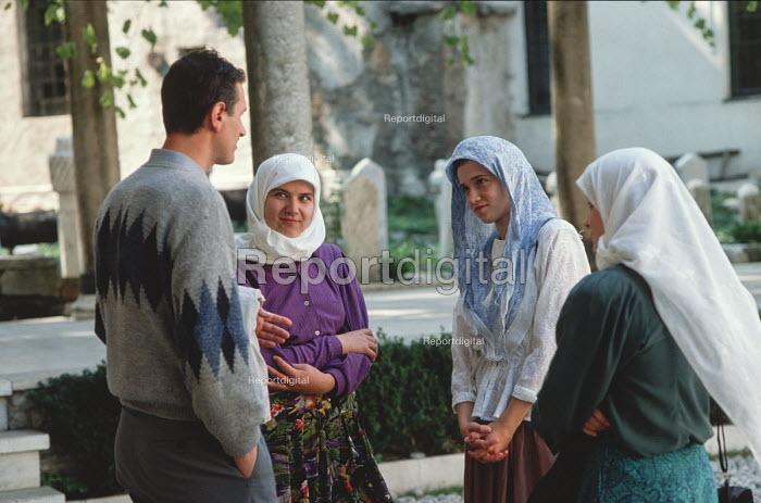 Young Muslims meet at the main Gazi Husrev-beg mosque in Sarajevo, Bosnia - Martin Mayer - 1990-09-12