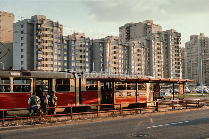 Tram and high rise housing in suburbs of Sarajevo, Bosnia. Also visible advert on side of tram for the East German film Orwo (now discontinued) - Martin Mayer - 1990-09-12
