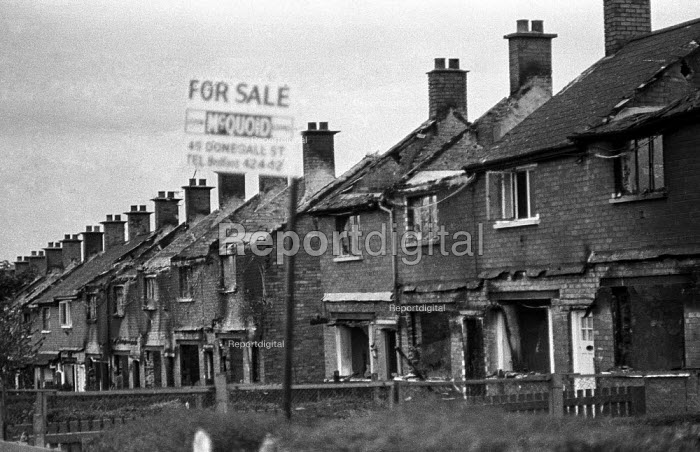 Houses burnt out by departing Protestants, Ardoyne estate, Belfast, Northern Ireland, 1971 after clashes between the Protestant and Catholic communities. - Martin Mayer - 1971-08-13