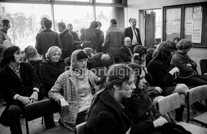 Unemeployed men and women waiting to see an official in a Derry dole office - Martin Mayer - 1971-08-13