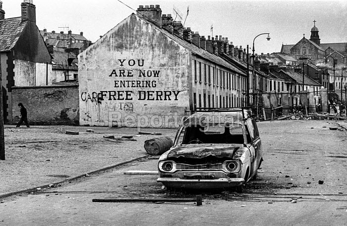 You are now entering free Derry. Entrance to the no-go Bogside, Derry, Northern Ireland, 1971 where British troops were kept out by armed IRA men after the introduction of internment - Martin Mayer - 1971-08-13