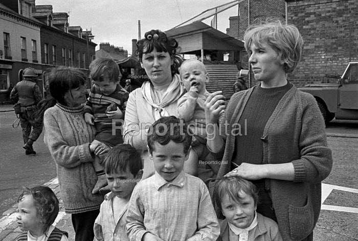 Catholic women (L-R) Betty Dorrian, Margaret Watters and Margaret Garland with their children protesting at a British army post in the Catholic enclave of Short Strand in East Belfast on day 2 of internment without trial - Martin Mayer - 1971-08-10