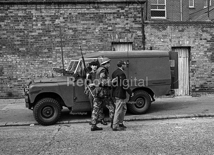 Catholic man Mr James Quinn is arrested by British soldiers in the Catholic Short Strand enclave of East Belfast after he complained about the UVF wrecking houses vacated by Protestants so that Catholics could not use them. - Martin Mayer - 1971-08-10