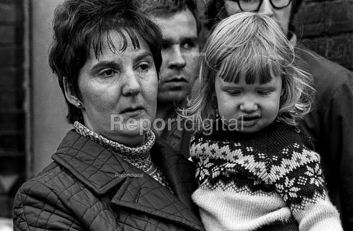 Mrs Quinn with her daughter Maria after witnessing the arrest of her husband James Quinn by British army, 1971 in the Catholic area of Short Strand, East Belfast on day 2 of internment without trial - Martin Mayer - 1971-08-10