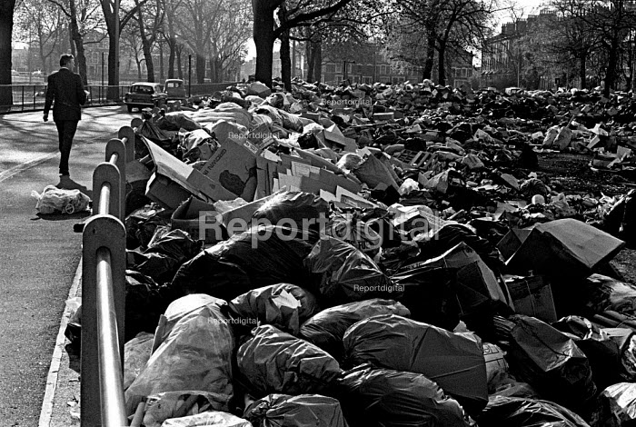 Rubbish piled high in a park, council workers pay strike, Hackney, London - Martin Mayer - 1970-11-04