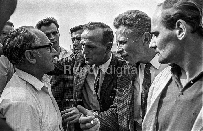 A GKN Sankey workers on strike argue with a union official over whether he will support their strike for higher pay. The strike affected many parts of the car industry leading to layoffs in several Austin Morris and Triumph factories. - Martin Mayer - 1970-08-01