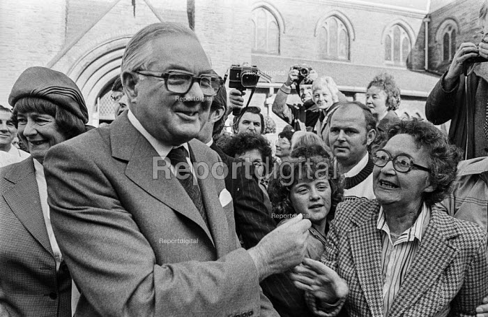 A supporter trying to shake Jim Callaghan's hand as he leaves church before the 1978 Labour Party conference in Blackpool. Behind him is his wife Audrey (L) - Martin Mayer - 1978-10-01