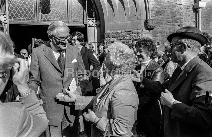 A supporter trying to shake Jim Callaghan's hand as he leaves church before the 1978 Labour Party conference in Blackpool. Behind him is his wife Audrey (in hat). - Martin Mayer - 1978-10-01