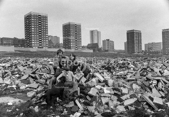 Children play on rubble of old terraced streets as high rise council flats rise in the distance, Everton, Liverpool. - Martin Mayer - 1972-04-24