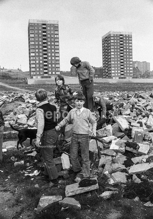 Children play on rubble of old terraced streets as high rise council flats rise in the distance, Everton, Liverpool. - Martin Mayer - 1972-04-26