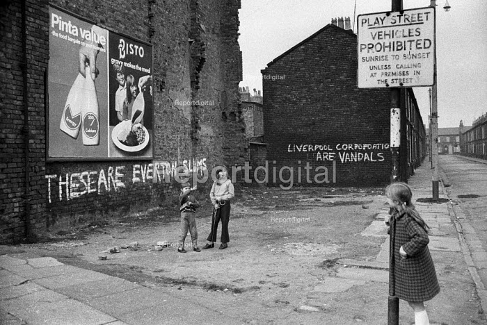 Children play in abandoned terraced streets, condemned as slums, next to slogans protesting at slum housing and clearance policy, Everton, Liverpool. - Martin Mayer - 1972-04-26