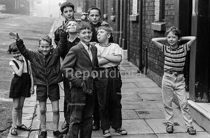 Children playing in the street in the cotton town of Ashton-under-Lyne, Greater Manchester before the traditional Wakes Week holiday - Martin Mayer - 1970-08-10