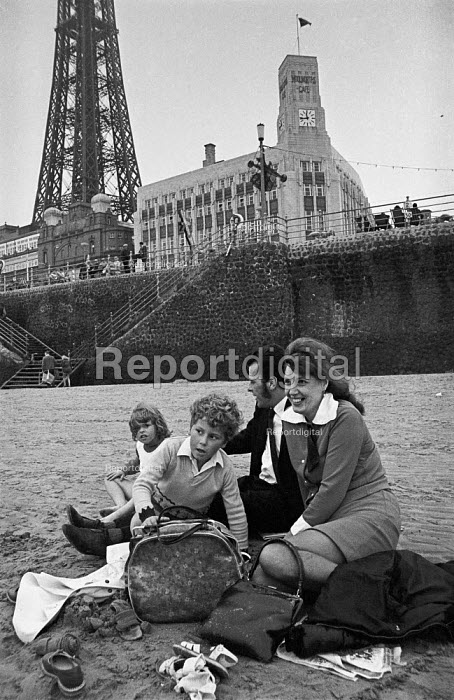 Young family from mill town Ashton-under-Lyne on the beach at Blackpool during Wakes Week - Martin Mayer - 1970-08-09