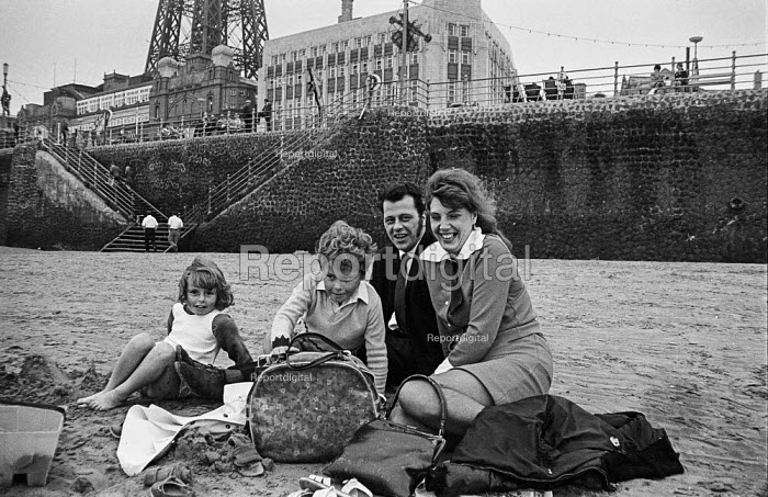 Young family from mill town Ashton-under-Lyne on the beach at Blackpool during Wakes Week - Martin Mayer - 1970-08-10