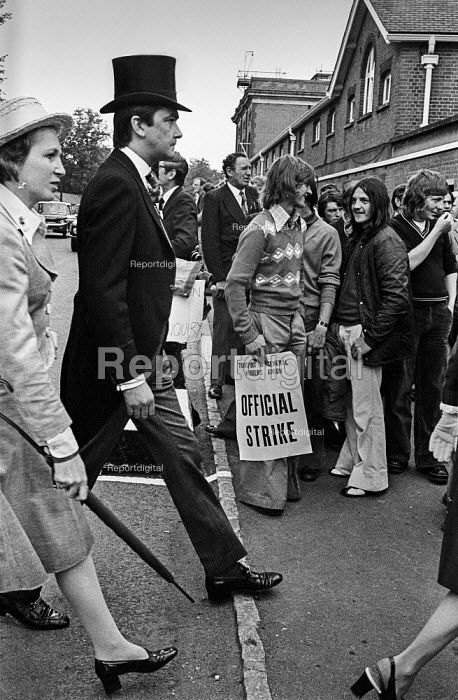 Stable lads strike 1975 . Grim faced racegoers in top hats walking past striking Newmarket stable lads picketing Royal Ascot races during their pay strike - Martin Mayer - 1975-06-18
