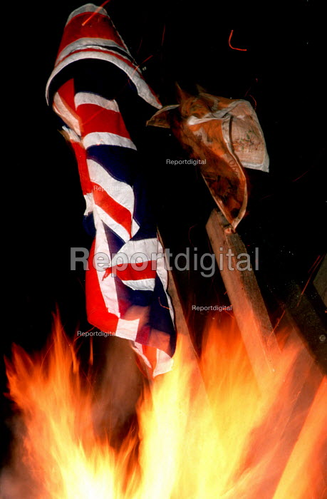 Union Jack buring on a republican bonfire, The Bogside, Derry, Northern Ireland 1989 - Mark Pinder - 1989-08-15