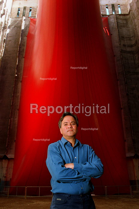 Artist and Turner Prize winner Anish Kapoor beneath his sculpture Tarantara. Baltic flour Mill, Gateshead which is being turned into a gallery for contemporary art, due to open Autumn 2001... - Mark Pinder - 1999-07-06