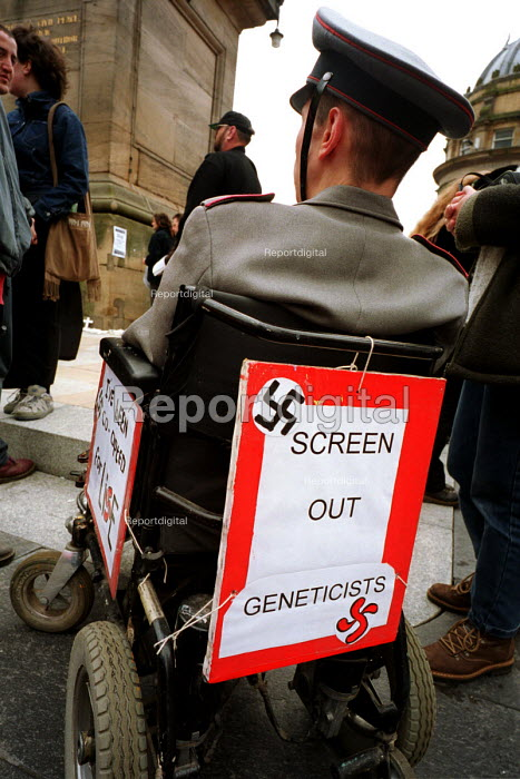 A wheelchair bound disability rights protestor makes a link between genetics and nazi eugenics. 04/2000. Newcastle Upon Tyne. ... - Mark Pinder - 1999-06-08