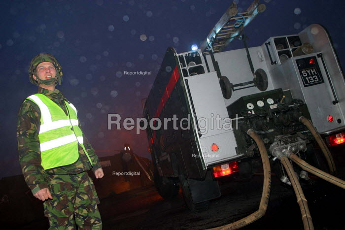 Soldiers manning a green goddess attending a minor fire at an industrial site in North Shields, Tyne and Wear. - Mark Pinder - 2002-11-24