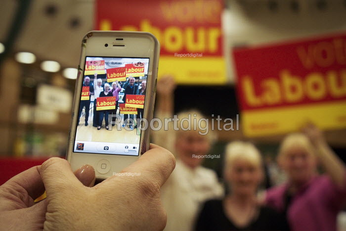 Labour Party supporters take a picture with their camera phone. Count for the South Shields parliamentary by-election.South Shields, Tyne and Wear, UK, 3/5 2013 - Mark Pinder - 2013-05-03