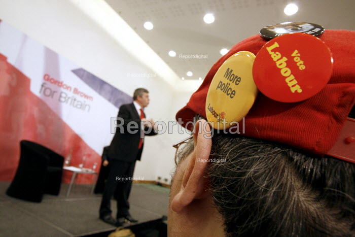'Unions Together' Labour leadership and deputy leadership hustings meeting, Centre For Life, Newcastle Upon Tyne, 3/6 2007. Gordon Brown addresses the meeting watched by a man wearing a badge calling for 'More Police' - Mark Pinder - 2007-06-03