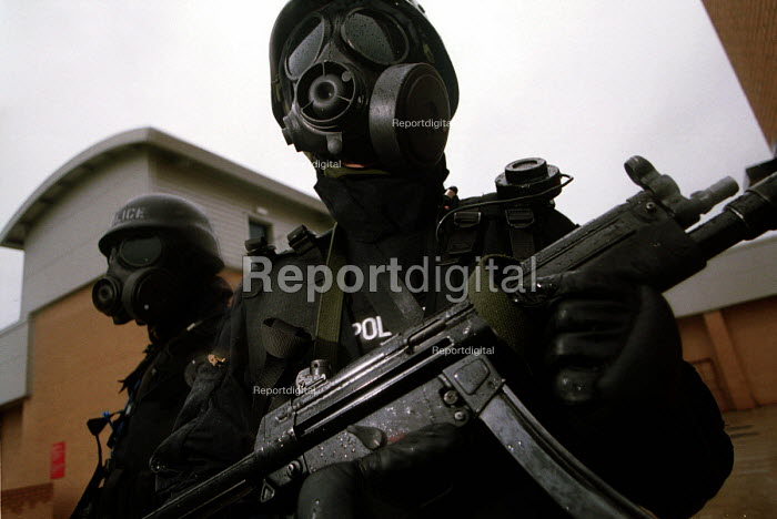 Armed Police with gas masks, firearms and tactical training at the Cleveland and Durham Police Tactical Training Centre, Stockton. - Mark Pinder - 2001-08-08