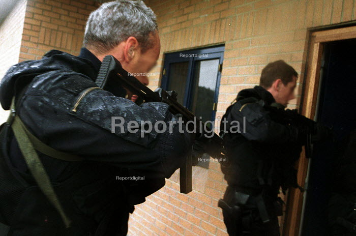 Armed Police forcing their way in, firearms and tactical training at the Cleveland and Durham Police Tactical Training Centre, Stockton. - Mark Pinder - 2001-08-08