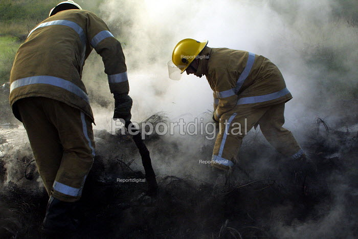 Firefighters put out a fire of abandoned tyres on empty land near North Shields. 23/9 2001. - Mark Pinder - 2001-09-23
